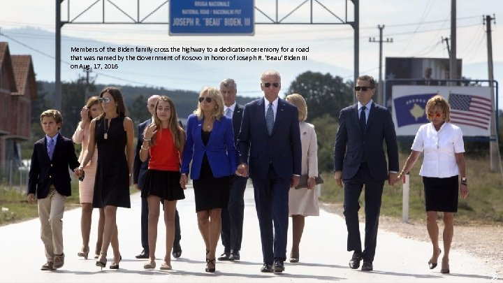 Members of the Biden family cross the highway to a dedication ceremony for a