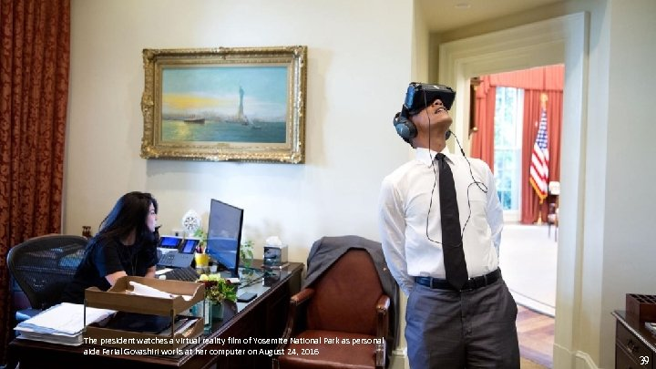 The president watches a virtual reality film of Yosemite National Park as personal aide