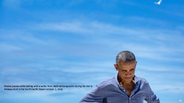 Obama pauses while talking with a writer from National Geographic during his visit to