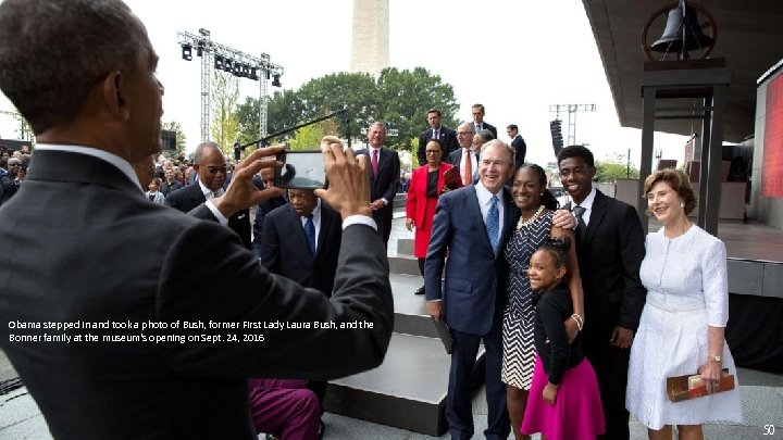 Obama stepped in and took a photo of Bush, former First Lady Laura Bush,