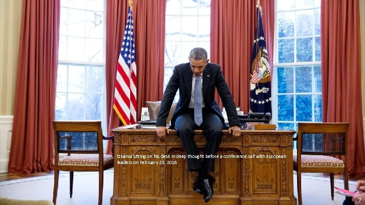 Obama sitting on his desk in deep thought before a conference call with European