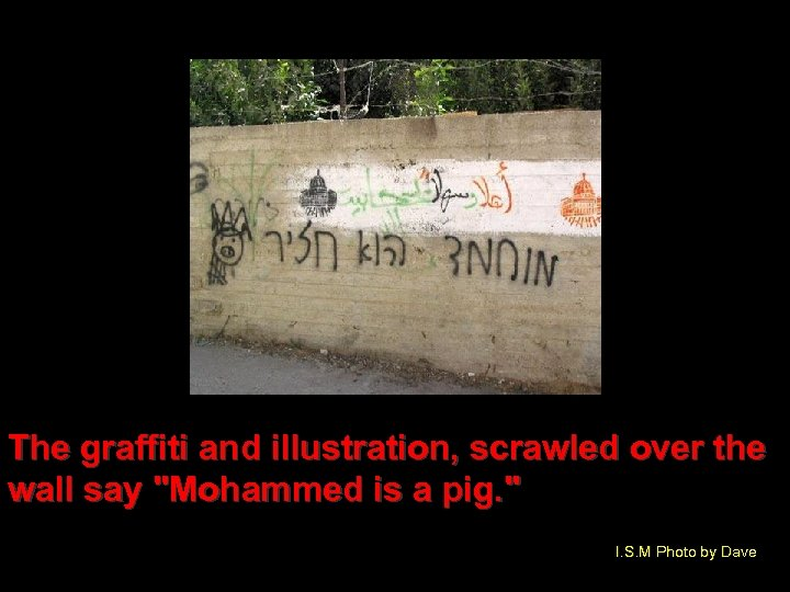 The graffiti and illustration, scrawled over the wall say