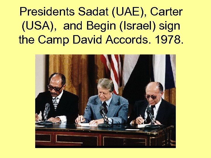 Presidents Sadat (UAE), Carter (USA), and Begin (Israel) sign the Camp David Accords. 1978.