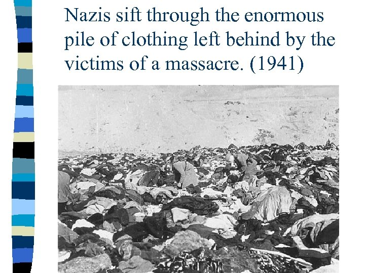 Nazis sift through the enormous pile of clothing left behind by the victims of