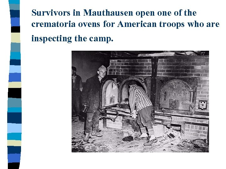 Survivors in Mauthausen open one of the crematoria ovens for American troops who are