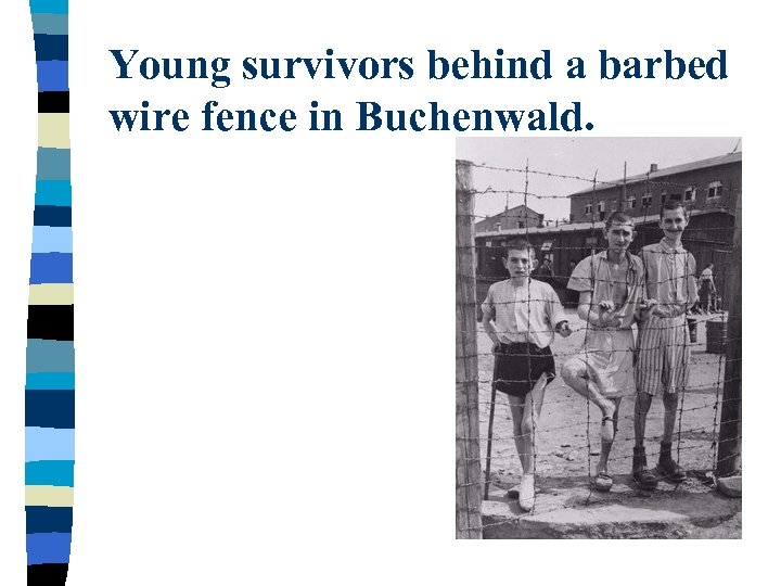 Young survivors behind a barbed wire fence in Buchenwald.
