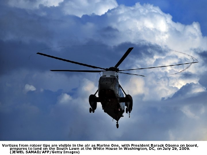 Vortices from rotoer tips are visible in the air as Marine One, with President