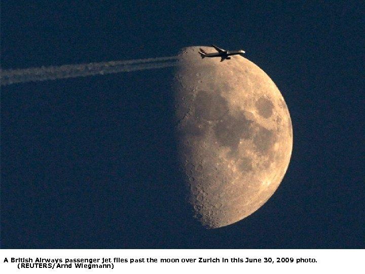 A British Airways passenger jet flies past the moon over Zurich in this June
