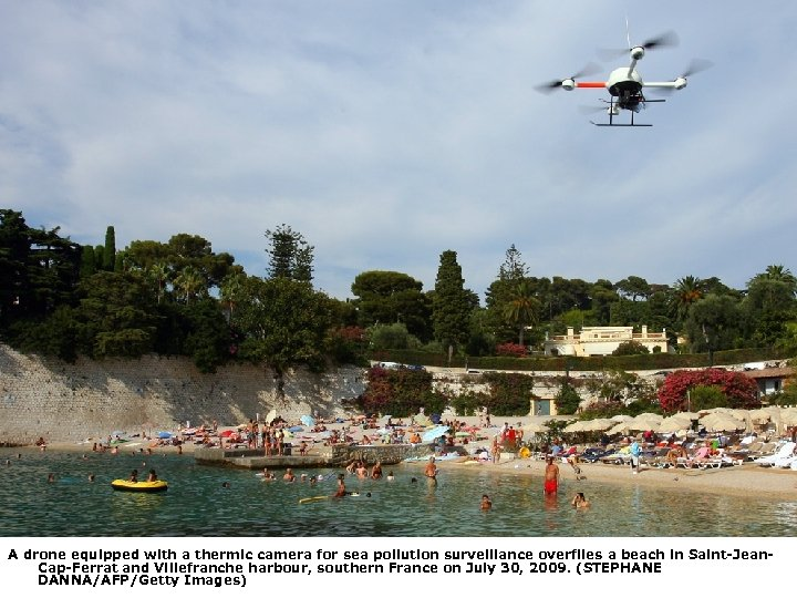 A drone equipped with a thermic camera for sea pollution surveillance overflies a beach