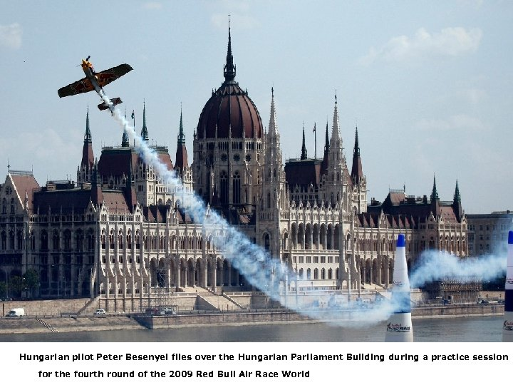 Hungarian pilot Peter Besenyei flies over the Hungarian Parliament Building during a practice session