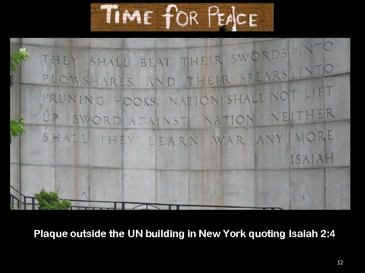 Plaque outside the UN building in New York quoting Isaiah 2: 4 12