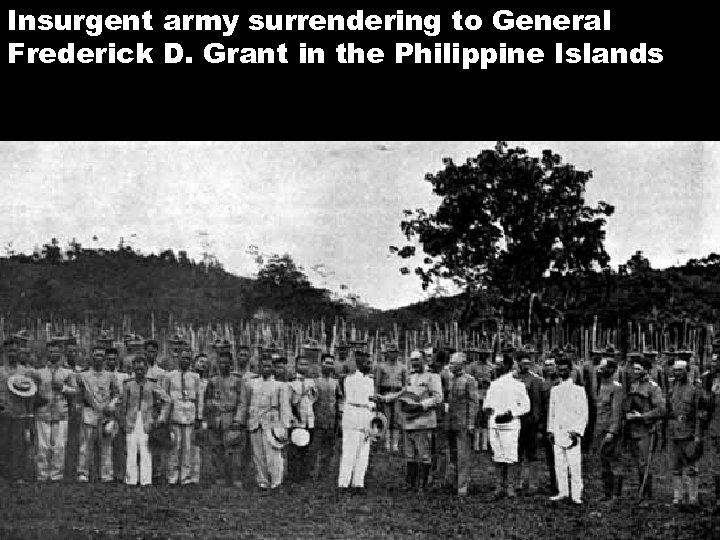 Insurgent army surrendering to General Frederick D. Grant in the Philippine Islands