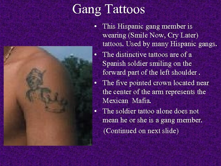 Gang Tattoos • This Hispanic gang member is wearing (Smile Now, Cry Later) tattoos.