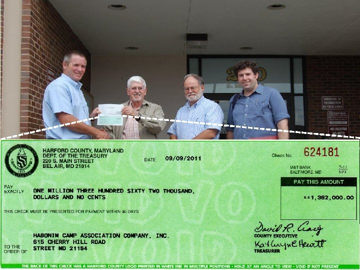 Harford County, MD agricultural preservation program administrator presents Rural Legacy check for $1, 326,