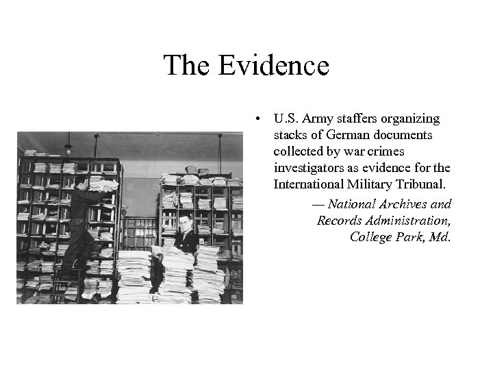The Evidence • U. S. Army staffers organizing stacks of German documents collected by