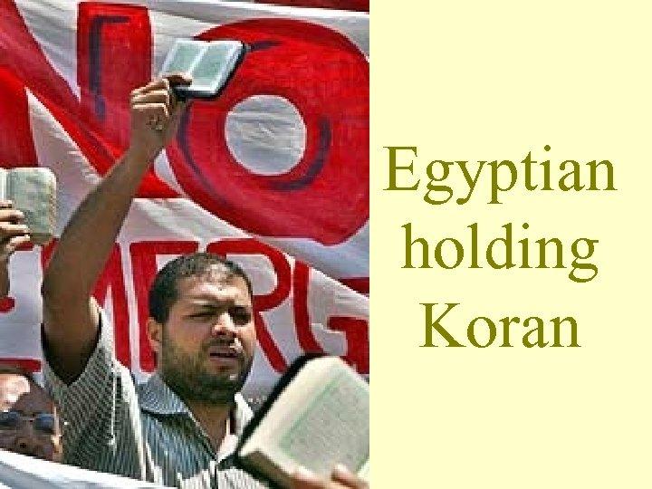 Egyptian holding Koran