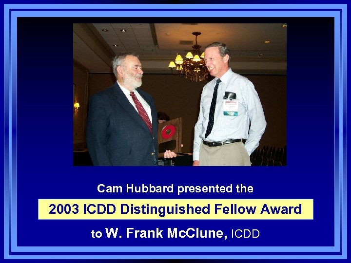 Cam Hubbard presented the 2003 ICDD Distinguished Fellow Award to W. Frank Mc. Clune,