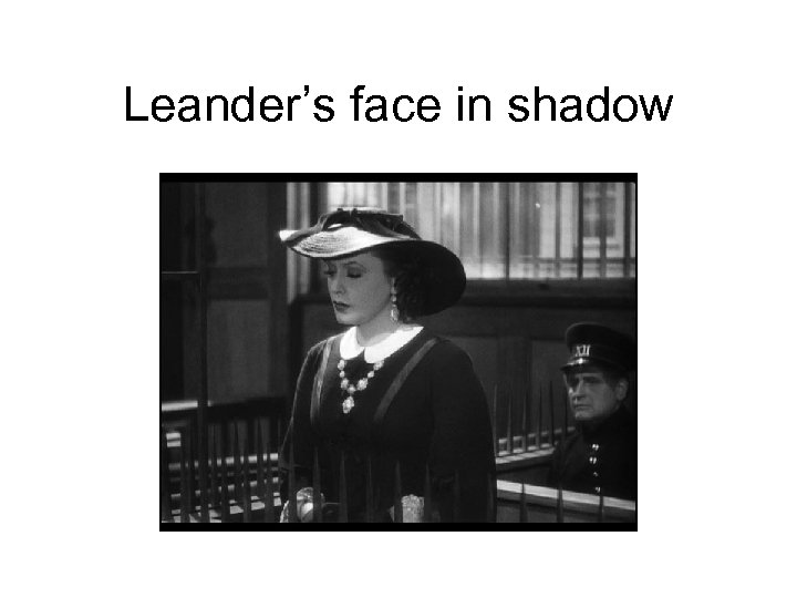 Leander's face in shadow