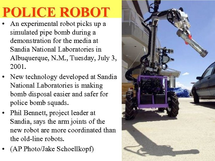 POLICE ROBOT • An experimental robot picks up a simulated pipe bomb during a