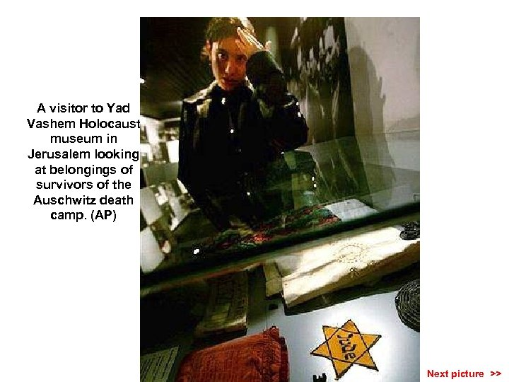 A visitor to Yad Vashem Holocaust museum in Jerusalem looking at belongings of survivors