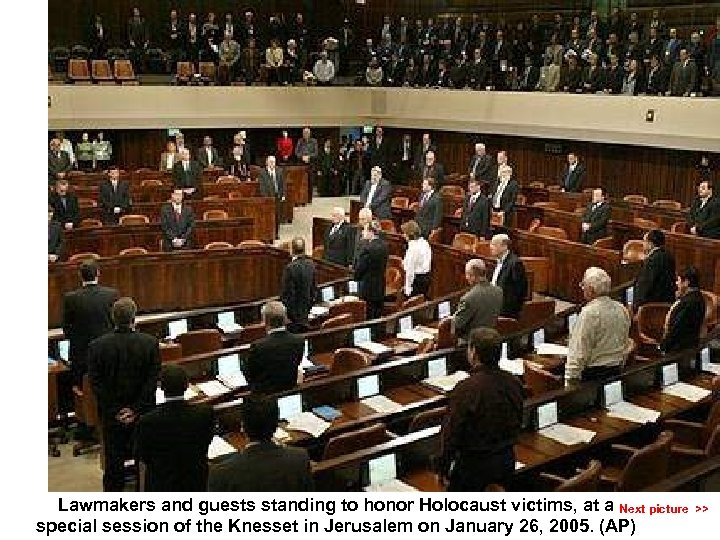 Lawmakers and guests standing to honor Holocaust victims, at a Next picture >> special