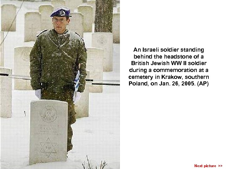 An Israeli soldier standing behind the headstone of a British Jewish WW II soldier