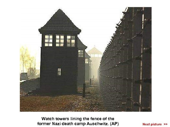 Watch towers lining the fence of the former Nazi death camp Auschwitz. (AP) Next