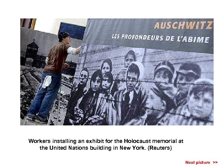 Workers installing an exhibit for the Holocaust memorial at the United Nations building in