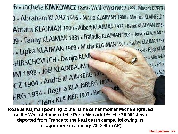 Rosette Klajman pointing to the name of her mother Micha engraved on the Wall