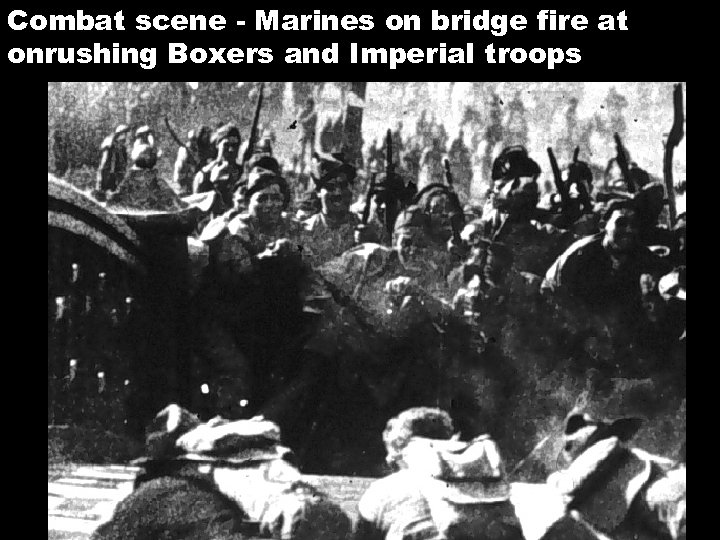 Combat scene - Marines on bridge fire at onrushing Boxers and Imperial troops