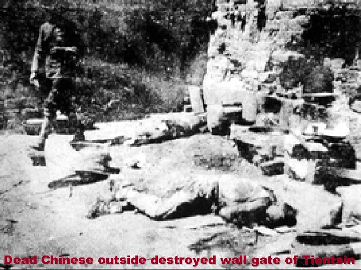 Dead Chinese outside destroyed wall gate of Tientsin