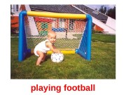 playing football  inflat ing bubble s